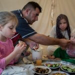 A displaced family from Mosul eat lunch at Baharka Camp on the outskirts of Erbil, Iraq.  © UNHCR/Cengiz Yar